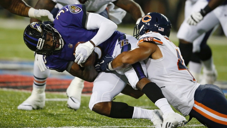 Chicago Bears linebacker Isaiah Irving, right, tackles Baltimore Ravens quarterback Robert Griffin III (3) during the first half of the Pro Football Hall of Fame NFL preseason game Thursday, Aug. 2, 2018, in Canton, Ohio.