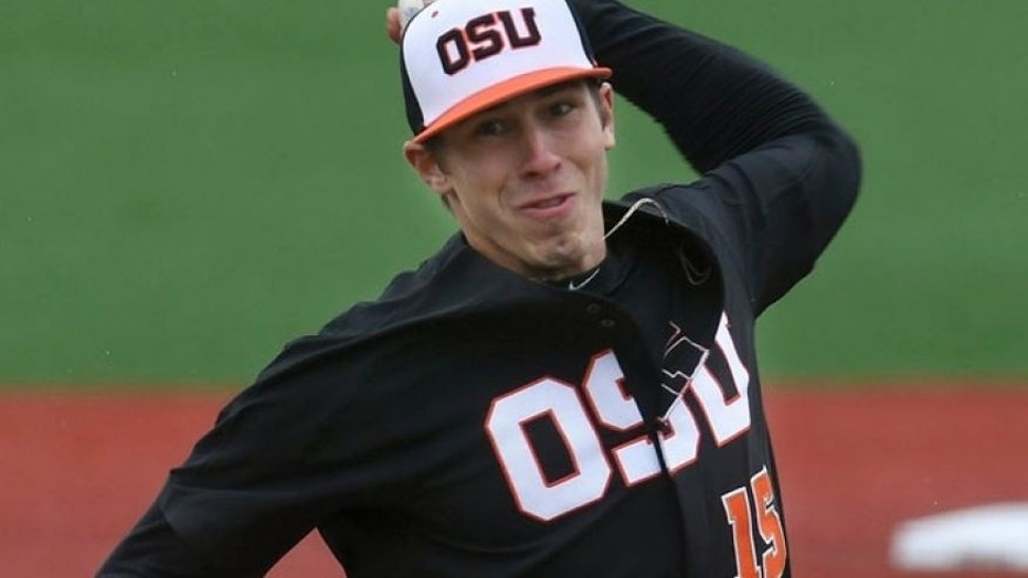 Oregon State pitcher Luke Heimlich throws during an NCAA college baseball game against UC Davis in Corvallis, Ore.