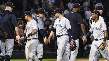 The New York Yankees celebrate a 7-3 win over the Chicago White Sox in a baseball game Wednesday, Aug. 8, 2018, in Chicago. (AP Photo/David Banks)