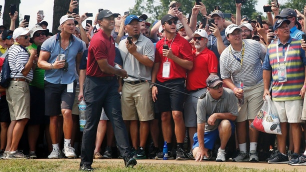 Tiger Woods watches his shot from the eighth fairway during the final round of the PGA Championship golf tournament at Bellerive Country Club, Sunday, Aug. 12, 2018, in St. Louis. (AP Photo/Brynn Anderson)