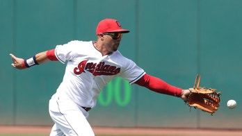 Cleveland Indians' Leonys Martin reaches but can't get to a ball hit by Los Angeles Angels' David Fletcher in the fourth inning of a baseball game, Sunday, Aug. 5, 2018, in Cleveland. Fletcher hit a single and advanced to second base on Martin's error. (AP Photo/Tony Dejak)