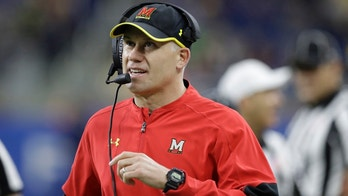 FILE - In this Dec. 26, 2016, file photo, Maryland head coach DJ Durkin walks the sideline during the first half of the Quick Lane Bowl NCAA college football game against Boston College in Detroit. Maryland placed the head of the football team's strength and conditioning staff on paid leave while it investigates claims he verbally abused and humiliated players, a person briefed on the situation said. The person spoke to The Associated Press on Saturday, Aug. 11, 2018, on condition of anonymity because Maryland had not announced the decision regarding Rick Court. The person says athletic director Damon Evans spoke with the football team Saturday morning and Durkin was still leading the program.  (AP Photo/Carlos Osorio, File)