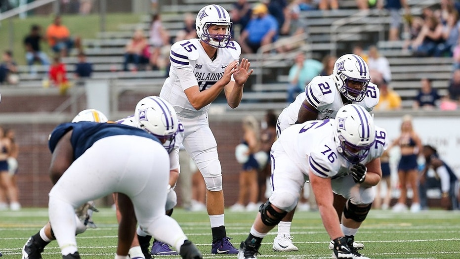 Furman quarterback Harris Roberts (15) is enrolled in an educational partnership program that allows him to play for the Paladins while attending classes at rival Clemson.