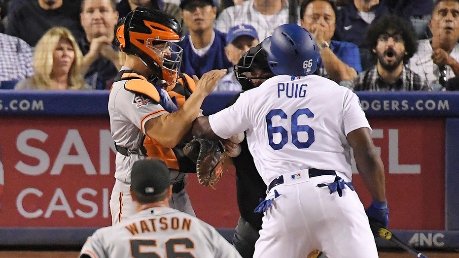 Dodgers outfielder Yasiel Puig, right, and Giants catcher Nick Hundley were involved in a brawl Tuesday.