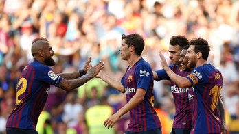 FC Barcelona's Lionel Messi, right, celebrates after scoring during the Joan Gamper trophy friendly soccer match between FC Barcelona and Boca Juniors at the Camp Nou stadium in Barcelona, Spain, Wednesday, Aug. 15, 2018. (AP Photo/Manu Fernandez)