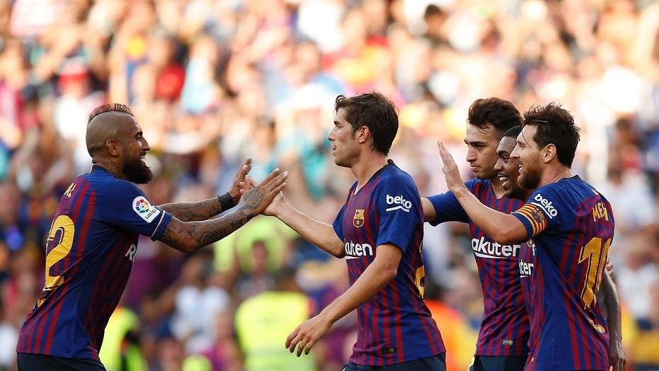 Clubs like FC Barcelona, pictured, featuring Lionel Messi, right, will play regular-season matches in the U.S. under a new agreement reached by La Liga.
