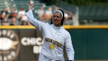 Sister Mary Jo Sobieck throws out a ceremonial first pitch before a baseball game between the Kansas City Royals and the Chicago White Sox, Saturday, Aug. 18, 2018, in Chicago. (AP Photo/Nam Y. Huh)