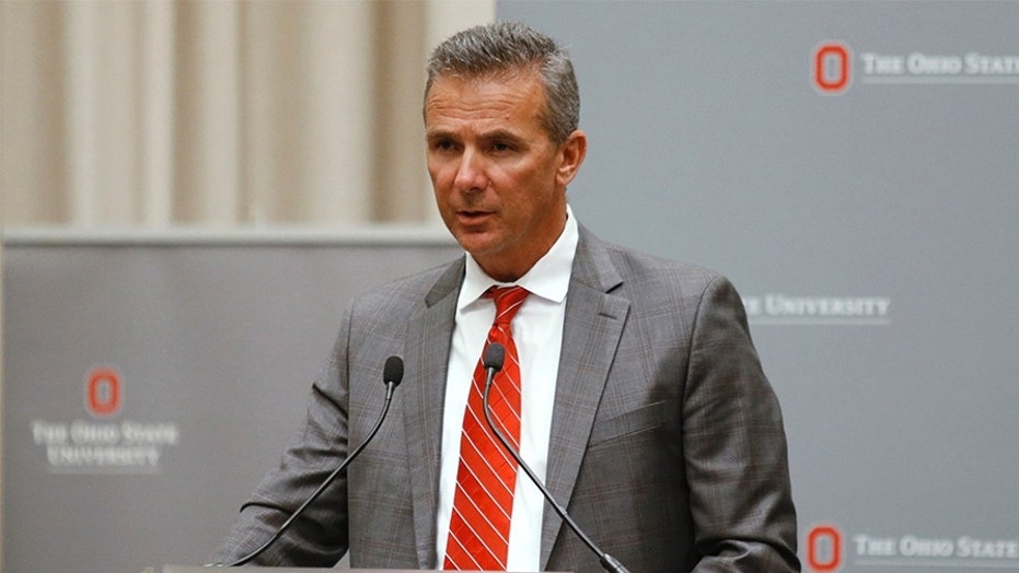 """Ohio State University head football Urban Meyer apologized Friday to Courtney Smith, the ex-wife of his former assistant coach, and for his """"lack of more action"""" regarding his handling of domestic abuse allegations."""