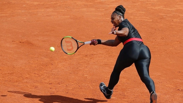 "FILE - In this May 29, 2018 file photo, Serena Williams of the U.S. returns a shot against Krystyna Pliskova of the Czech Republic during their first round match of the French Open tennis tournament at the Roland Garros stadium in Paris. Serena Williams will no longer be allowed to wear her sleek, figure-hugging catsuit at the French Open. The French Tennis Federation president, Bernard Giudicelli, says the tournament that Williams has won three times is introducing a dress code to regulate players' uniforms because ""I think that sometimes, we've gone too far."" (AP Photo/Michel Euler, File)"