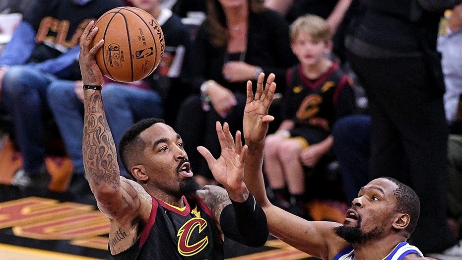 Cleveland Cavaliers guard JR Smith (5) shoots the ball against Golden State Warriors forward Kevin Durant (35) during the first quarter in game three of the 2018 NBA Finals at Quicken Loans Arena.