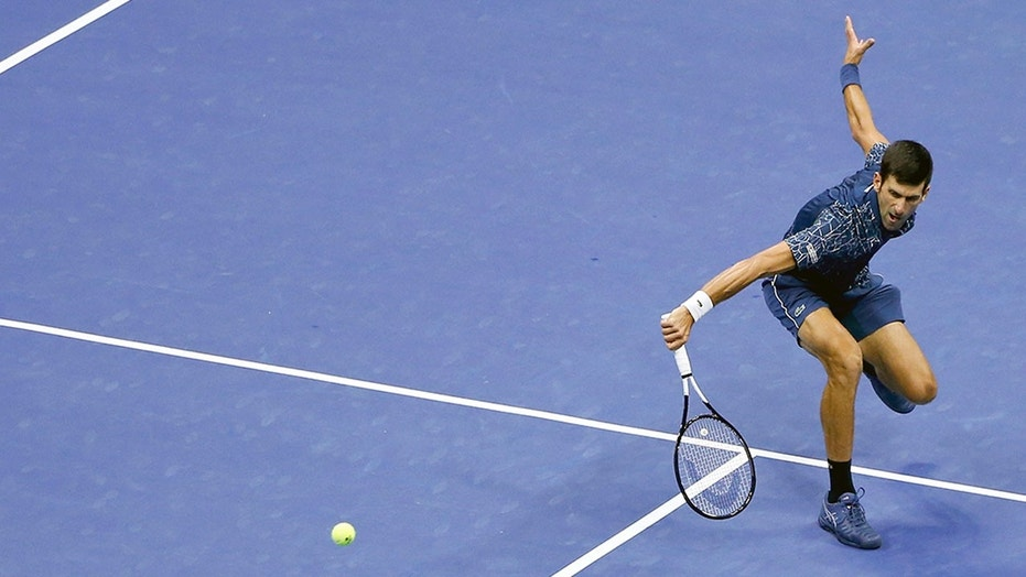 Novak Djokovic, of Serbia, returns a shot to Juan Martin del Potro, of Argentina, during the men's final of the U.S. Open tennis tournament, Sunday, Sept. 9, 2018, in New York. (AP Photo/Jason DeCrow)