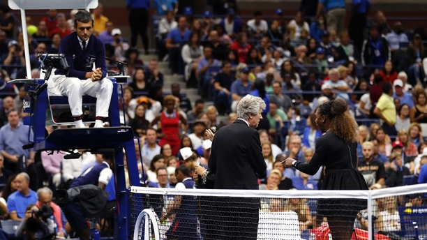 Serena Williams, right, talks with referee Brian Earley as chair umpire Carlos Ramos looks on during the women's final of the U.S. Open tennis tournament against Naomi Osaka, of Japan, Saturday, Sept. 8, 2018, in New York. (AP Photo/Adam Hunger)