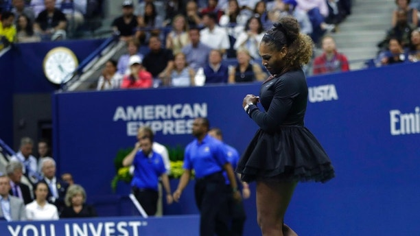 Serena Williams slams her racket on the court during the women's final of the U.S. Open tennis tournament against Naomi Osaka, of Japan, Saturday, Sept. 8, 2018, in New York. (AP Photo/Julio Cortez)