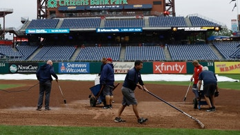 Grounds crew members work on the infield of Citizens Bank Park before a baseball game between the Philadelphia Phillies and Washington Nationals, Monday, Sept. 10, 2018, in Philadelphia. (AP Photo/Matt Slocum)