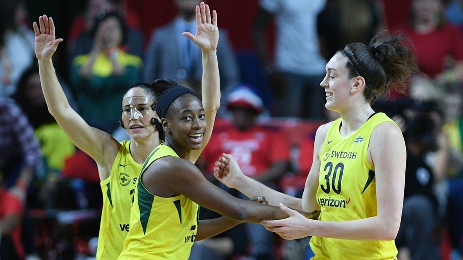 Seattle Storm players Sue Bird Jewell Loyd and Breanna Stewart celebrate during the first half of Game 3 of the WNBA Finals Wednesday night in Fairfax Va