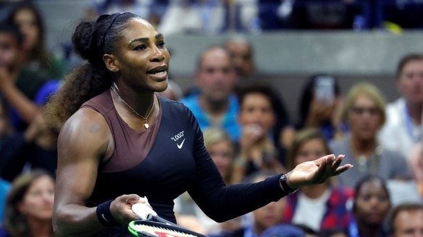Serena Williams looks at her box during the women's final of the U.S. Open tennis tournament against Naomi Osaka, of Japan, Saturday, Sept. 8, 2018, in New York. (AP Photo/Julio Cortez)