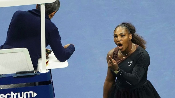 FILE - In this Saturday, Sept. 8, 2018, record photo, Serena Williams argues with a chair referee during a compare opposite Naomi Osaka, of Japan, during a women's finals of a U.S. Open tennis contest during a USTA Billie Jean King National Tennis Center,  in New York. Some black women contend Serena Williams' knowledge during a U.S. Open final resonates with them. They contend they are mostly forced to watch their tinge and difference in a workplace in ways that group and other women are not. Otherwise, they say, they risk being branded an Angry Black Woman. (Photo by Greg Allen/Invision/AP, File)