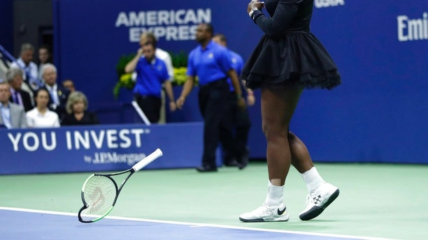 Serena Williams slams her pole on a justice during a women's final of a U.S. Open tennis contest opposite Naomi Osaka, of Japan, Saturday, Sept. 8, 2018, in New York. (AP Photo/Julio Cortez)