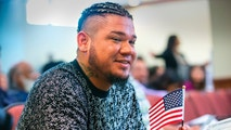 Seattle Mariners pitcher Felix Hernandez is sworn in as a U.S. citizen at the U.S. Citizenship and Immigration Services Field office in Tukwila, Wash., on Monday, Sept. 24, 2018. (Mike Siegel/ The Seattle Times via AP)