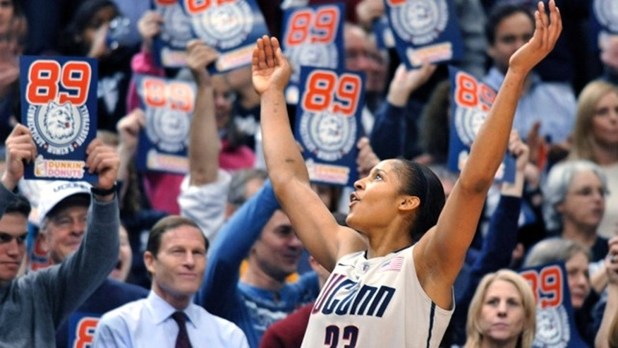Connecticut forward Maya Moore celebrates near the end of an NCAA college basketball game against Florida State in Hartford, Conn., Tuesday, Dec. 21, 2010. Connecticut beat Florida State 93-62 to to set an NCAA record for consecutive wins, at 89. (AP Photo/Jessica Hill)