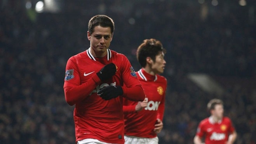 Manchester United's Javier Hernandez, left, celebrates after scoring against Stoke during their English Premier League soccer match at Old Trafford Stadium, Manchester, England, Tuesday, Jan. 31, 2012. (AP Photo/Jon Super)