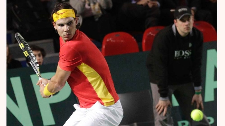 Spain's Rafael Nadal returns the ball towards Belgium's Ruben Bemelmans, on the first day at the World Group, first round of the Davis Cup in Charleroi, Belgium, Friday, March 4, 2011.  (AP Photo/Yves Logghe)