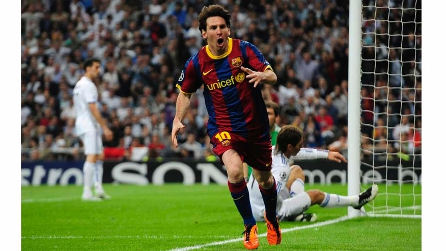 FC Barcelona's Lionel Messi from Argentina reacts after scoring against Real Madrid during their semifinal first leg Champions League soccer match at the Bernabeu stadium in Madrid, Spain, Wednesday, April 27, 2011. (AP Photo/Manu Fernandez)