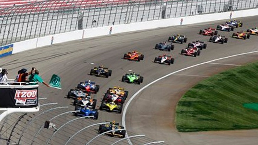 Drivers take the green flag to begin the IndyCar Series' Las Vegas Indy 300 auto race on Sunday, Oct. 16, 2011, in Las Vegas. Dan Wheldon, of England, was killed in a multi-car wreck early in the race. (AP Photo/Isaac Brekken)