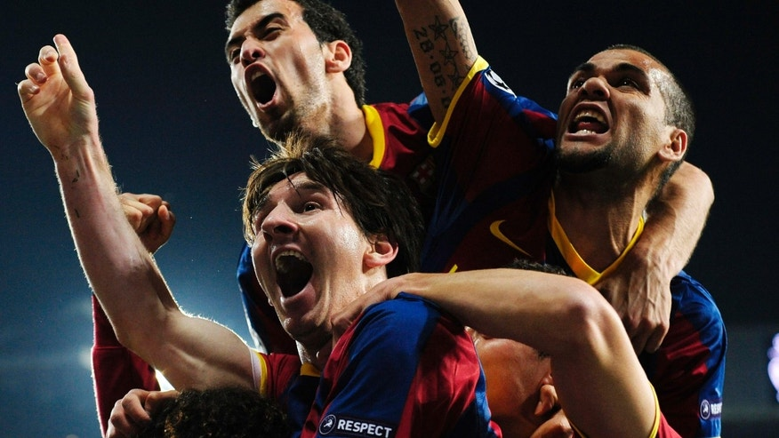 FC Barcelona's Lionel Messi from Argentina, left, reacts after scoring against Real Madrid during their semifinal first leg Champions League soccer match at the Bernabeu stadium in Madrid, Spain, Wednesday, April 27, 2011. (AP Photo/Manu Fernandez)