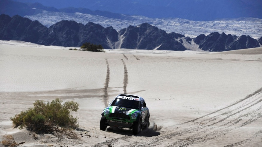 Mini's driver Stephane Peterhansel and co-driver Jean Paul Cottret both from France, compete in the  fifth stage of the 2012 Argentina-Chile-Peru Dakar Rally between Chilecito and Fiambala, Argentina, Thursday Jan. 5, 2012. (AP Photo/Jerome Prevost, Pool)