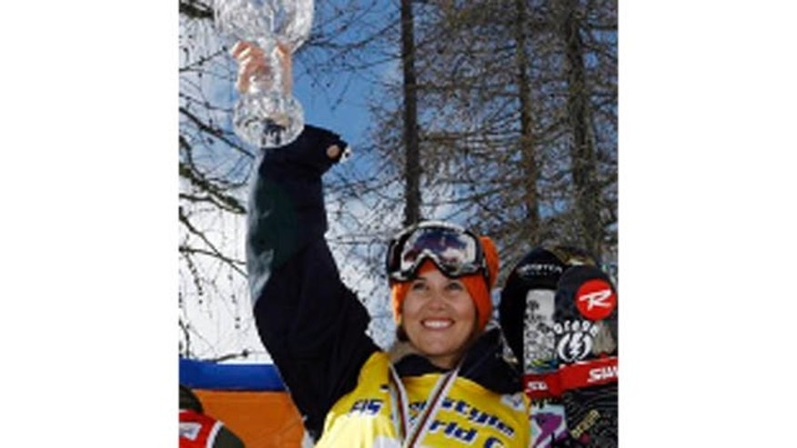 FILE - In this March 12, 2008, file photo, Sarah Burke, of Canada, celebrates on the podium after winning the women's halfpipe freestyle title at the World Cup finals in Valmalenco, Italy. Burke died Thursday, Jan. 19, 2012, nine days after crashing at the bottom of the superpipe during a training run in Utah. She was 29. Burke was injured Jan. 11 while training at a personal sponsor event at the Park City Mountain resort.  (AP Photo/Alessandra Tarantino, File)