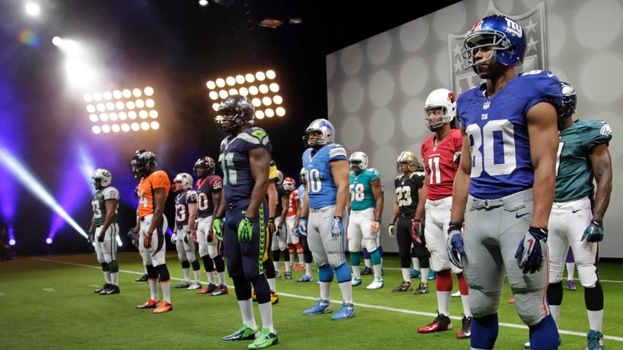 NFL uniforms are displayed during a presentation in New York, Tuesday, April 3, 2012. The league and Nike showed off the new look in grand style Tuesday with a gridiron-styled fashion show at a Brooklyn film studio. (AP Photo/Seth Wenig)