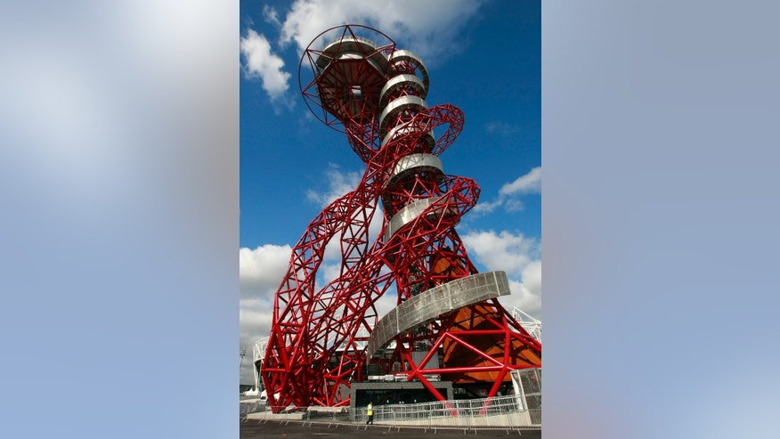 The ArcelorMittal Orbit sculpture before its official unveiling at the Olympic Park, London, Friday May 11, 2012. The steel sculpture designed by Anish Kapoor and Cecil Balmond stands 114.5 meters (376ft) high, 63% of of the sculpture is recycled steel and incorporates the five Olympic rings. (AP Photo/Tim Hales)
