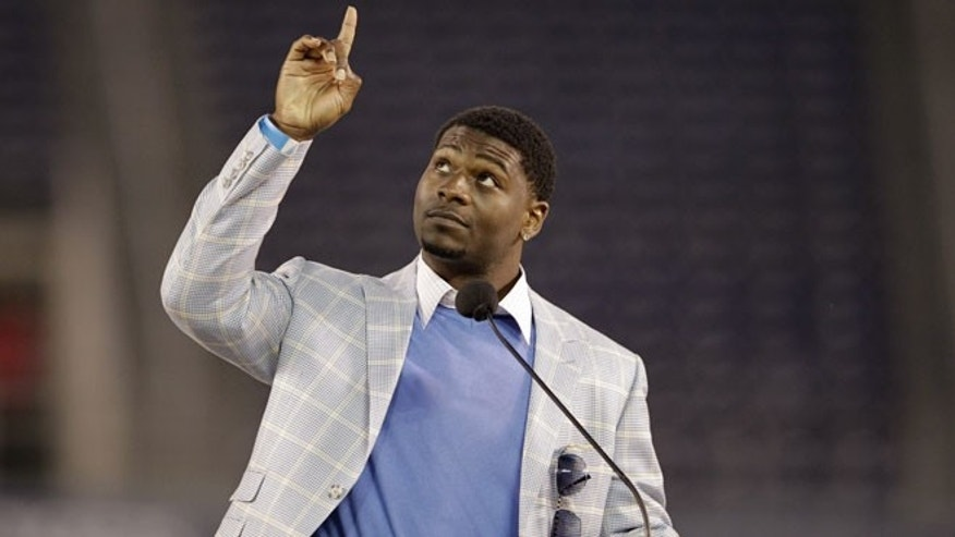 May 11, 2012: Former San Diego Chargers running back LaDainian Tomlinson points upward during a public memorial service for the late NFL football player Junior Seau at Qualcomm Stadium in San Diego.