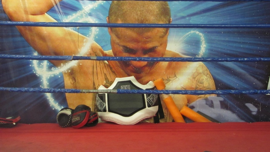 A large image of Tapia hangs behind a boxing ring at the gym Tapia co-owned.