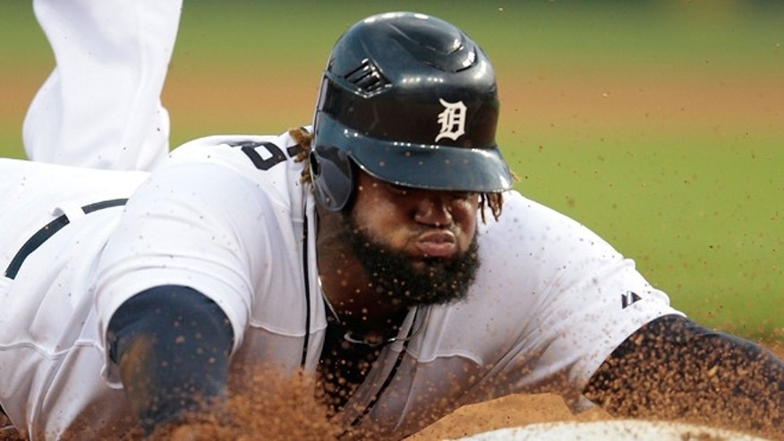 DETROIT, MI - JULY 16: Prince Fielder #28 of the Detroit Tigers slides into third base during the fifth inning of the game  against the Los Angeles Angels of Anaheim at Comerica Park on July 16, 2012 in Detroit, Michigan.  (Photo by Leon Halip/Getty Images)