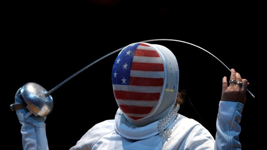 LONDON, ENGLAND - JULY 30:  Courtney Hurley of the United States looks on against Laura Flessel-Colovic of France during the Women's Epee Individual Fencing round 32 of on Day 3 of the London 2012 Olympic Games at ExCeL on July 30, 2012 in London, England.  (Photo by Hannah Johnston/Getty Images)