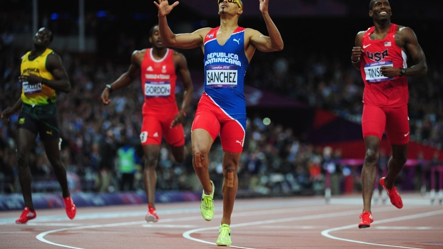 LONDON, ENGLAND - AUGUST 06:  Felix Sanchez of Dominican Republic celebrates after winning the gold medal in the Men's 400m Hurdles final on Day 10 of the London 2012 Olympic Games at the Olympic Stadium on August 6, 2012 in London, England.  (Photo by Stu Forster/Getty Images)