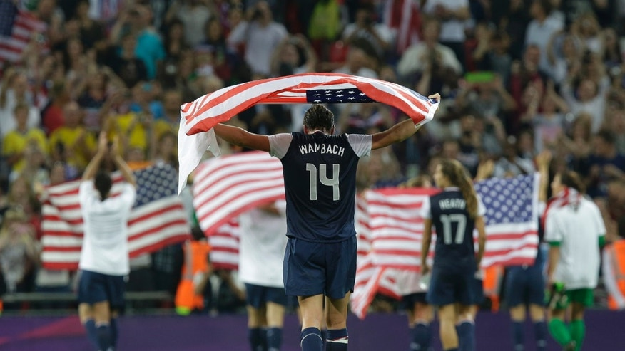 United States' Abby Wambach celebrates with teammates after winning the women's soccer gold medal match against Japan at the 2012 Summer Olympics, Thursday, Aug. 9, 2012, in London. (AP Photo/Lefteris Pitarakis)