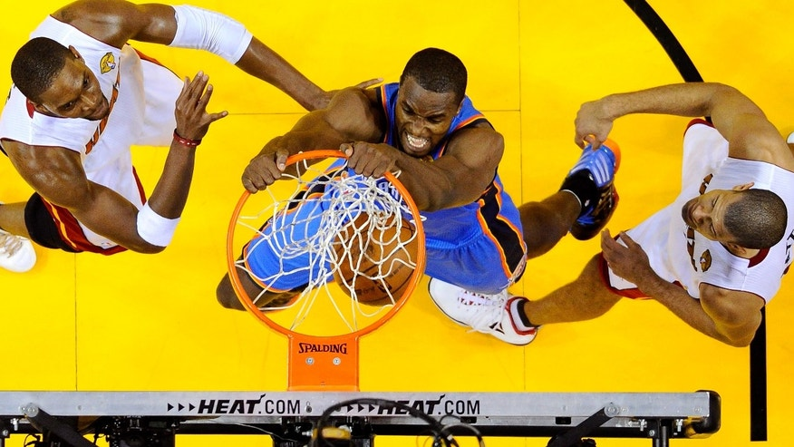 MIAMI, FL - JUNE 21:  Serge Ibaka #9 of the Oklahoma City Thunder dunks against Chris Bosh #1 and Shane Battier #31 of the Miami Heat in Game Five of the 2012 NBA Finals on June 21, 2012 at American Airlines Arena in Miami, Florida. NOTE TO USER: User expressly acknowledges and agrees that, by downloading and or using this photograph, User is consenting to the terms and conditions of the Getty Images License Agreement.  (Photo by Larry W. Smith-Pool/Getty Images) *** Local Caption *** Serge Ibaka