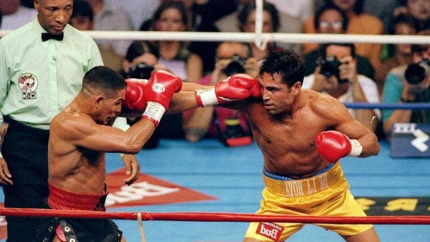 13 Sep 1997:  Boxer Oscar De La Hoya, right, battles Hector Camacho during a match at the Thomas and Mack Center in Las Vegas, Nevada. Mandatory Credit: Jed Jacobsohn  /Allsport
