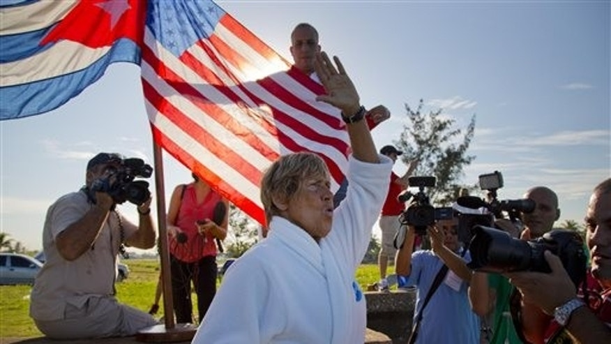 U.S. swimmer Diana Nyad, 64, salutes before her swim from Havana, Cuba, to Florida in Havana on Saturday, Aug. 31, 2013. Endurance athlete Nyad launched another bid Saturday to set an open-water record by swimming from Havana to the Florida Keys without a protective shark cage. (AP Photo/Ramon Espinosa)