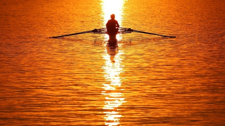SYDNEY, AUSTRALIA - MARCH 30: A rower heads out for training early morning before the Rowing World Cup at the Sydney International Rowing Centre on March 30, 2014 in Sydney, Australia.  (Photo by Mark Nolan/Getty Images)