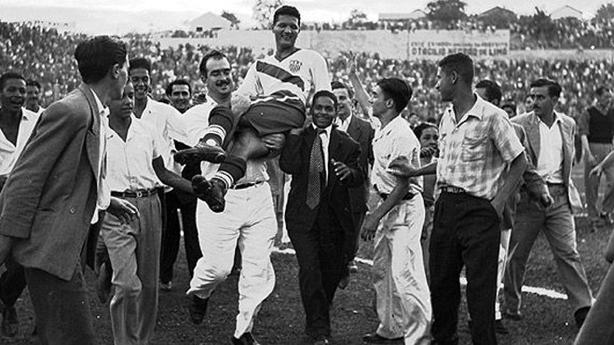 U.S. soccer player Joe Gaetjens is carried off the field by cheering fans after the U.S. defeated England, 1-0, on June 29, 1950, in a World Cup match in Belo Horizonte, Brazil. (Associated Press)