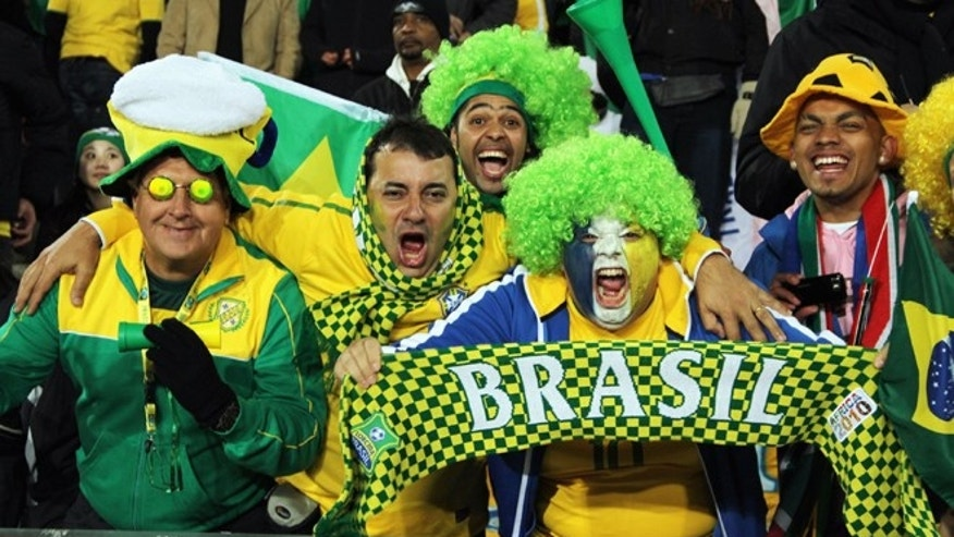 JOHANNESBURG, SOUTH AFRICA - JUNE 15:  Brazil fans enjoy the atmosphere during the 2010 FIFA World Cup South Africa Group G match between Brazil and North Korea at Ellis Park Stadium on June 15, 2010 in Johannesburg, South Africa.  (Photo by Stanley Chou/Getty Images)