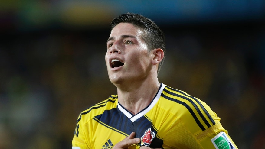 Colombia's James Rodriguez celebrates after scoring his side's fourth goal during the group C World Cup soccer match between Japan and Colombia at the Arena Pantanal in Cuiaba, Brazil, Tuesday, June 24, 2014. (AP Photo/Felipe Dana)