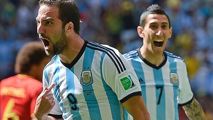 Argentina's Gonzalo Higuain, left, celebrates with Angel di Maria after scoring the opening goal during the World Cup quarterfinal soccer match between Argentina and Belgium at the Estadio Nacional in Brasilia, Brazil, Saturday, July 5, 2014. (AP Photo/Martin Meissner)