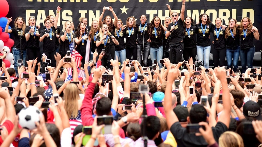 LOS ANGELES, CA - JULY 07:  The United States of America women's soccer team lead by Abby Wambach celebrate victory of the 2015 Women's World Cup during a rally at LA Live on July 7, 2015 in Los Angeles, California.  (Photo by Harry How/Getty Images)