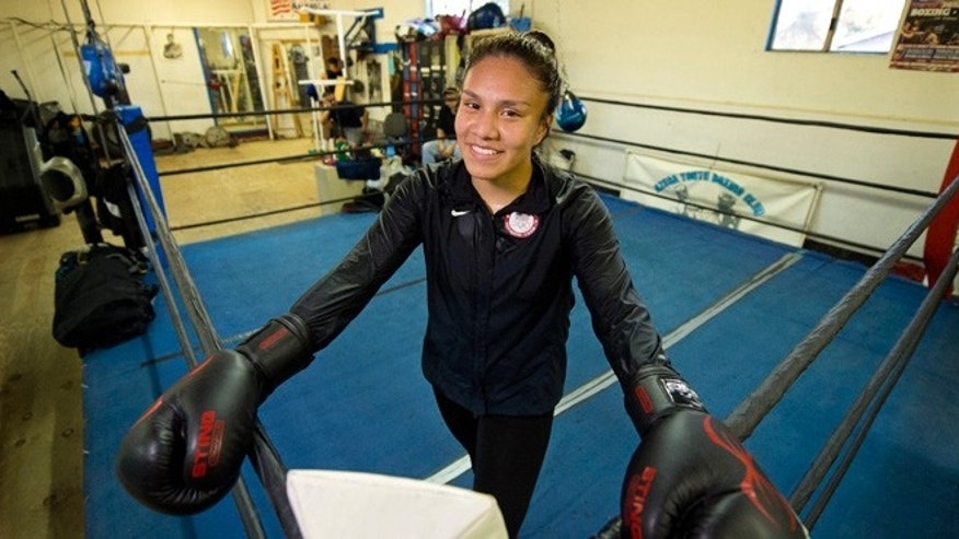 Jajaira Gonzalez poses during her workout at Azusa Youth Boxing Club, Wednesday, Oct. 21, 2015, in Azusa, Calif. The 132-pound Gonzalez is considered the next major American amateur boxing talent with her combination of punch volume and toughness. (AP Photo/Mark J. Terrill)