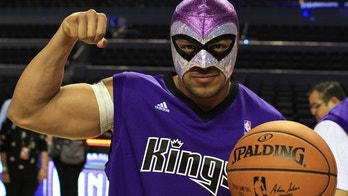 A Mexican lucha libre fighter wears a Sacramento Kings jersey and tries shooting layups during an NBA practice in Mexico City on Dec. 2. (Photo: Nathaniel Parish Flannery/Fox News Latino)